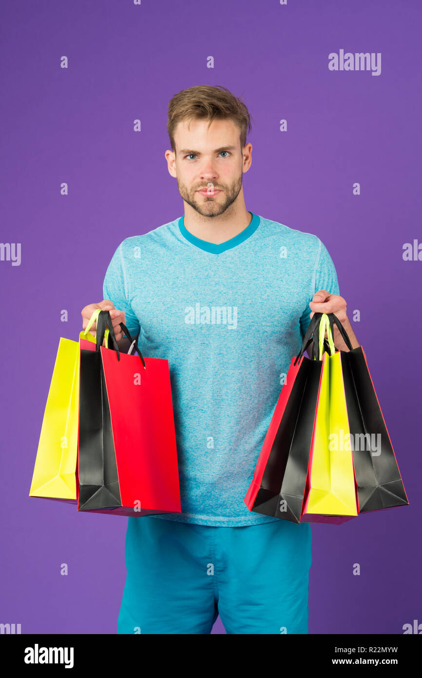 Capture opportunity. Man bearded face holds shopping bags. Guy bought lot sporty clothes and accessories. Man shopping on black friday. Guy bought lot items with discount. Seasonal sale concept. - Stock Image