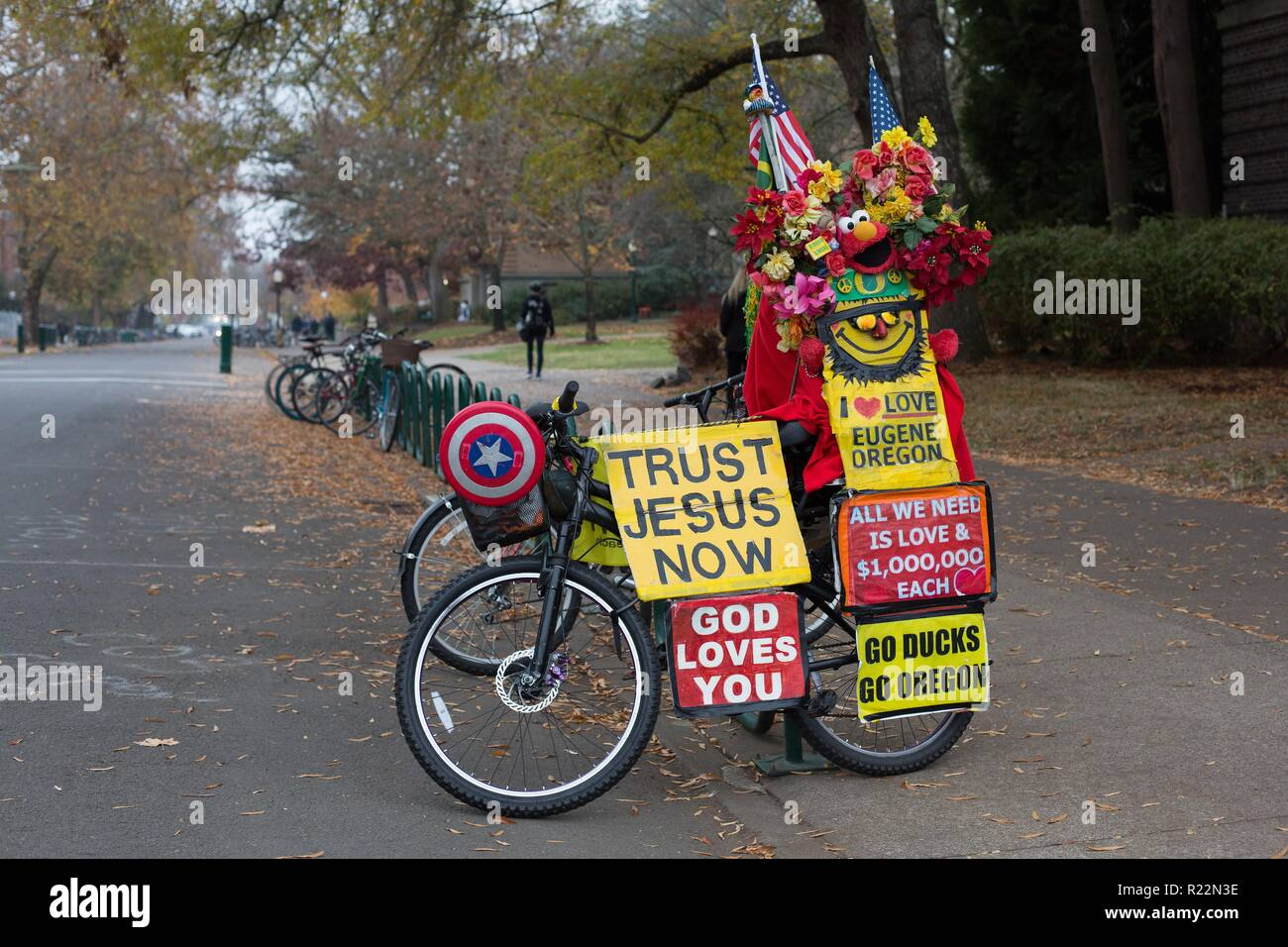 A bike decorated with religious and other slogans, at the University of Oregon in Eugene, OR, USA. - Stock Image