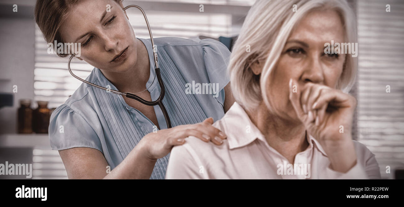 Doctor examining coughing patient - Stock Image
