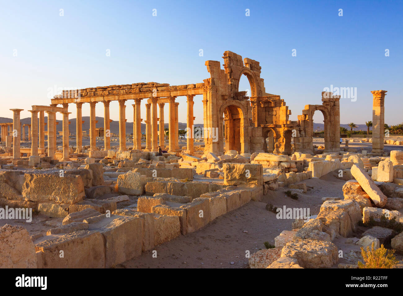 Palmyra, Homs Governorate, Syria - May 27th, 2009 :  Great Colonnade and Monumental Arch of Palmyra. The Monumental Arch was a 3rd century Roman ornam - Stock Image
