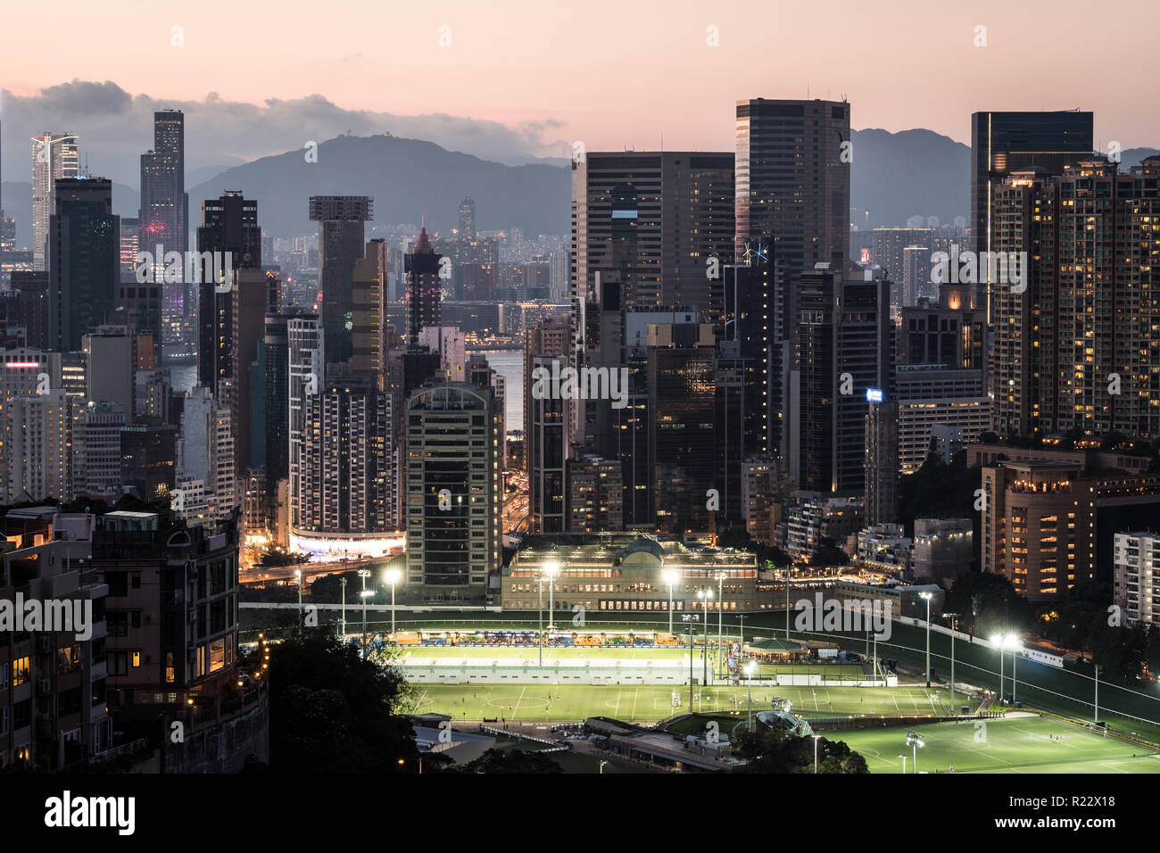 Sunset over Happy Valley district, famous for its horse racecourse  in Hong Kong island, Hong Kong SAR in China - Stock Image