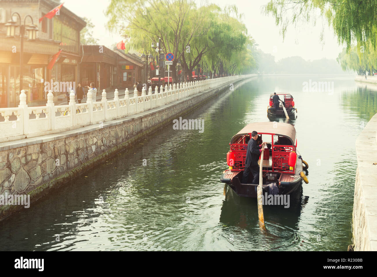 China traditional tourist boats on Beijing canals of Qianhai lake at ShiChaHai district in Beijing, China Stock Photo