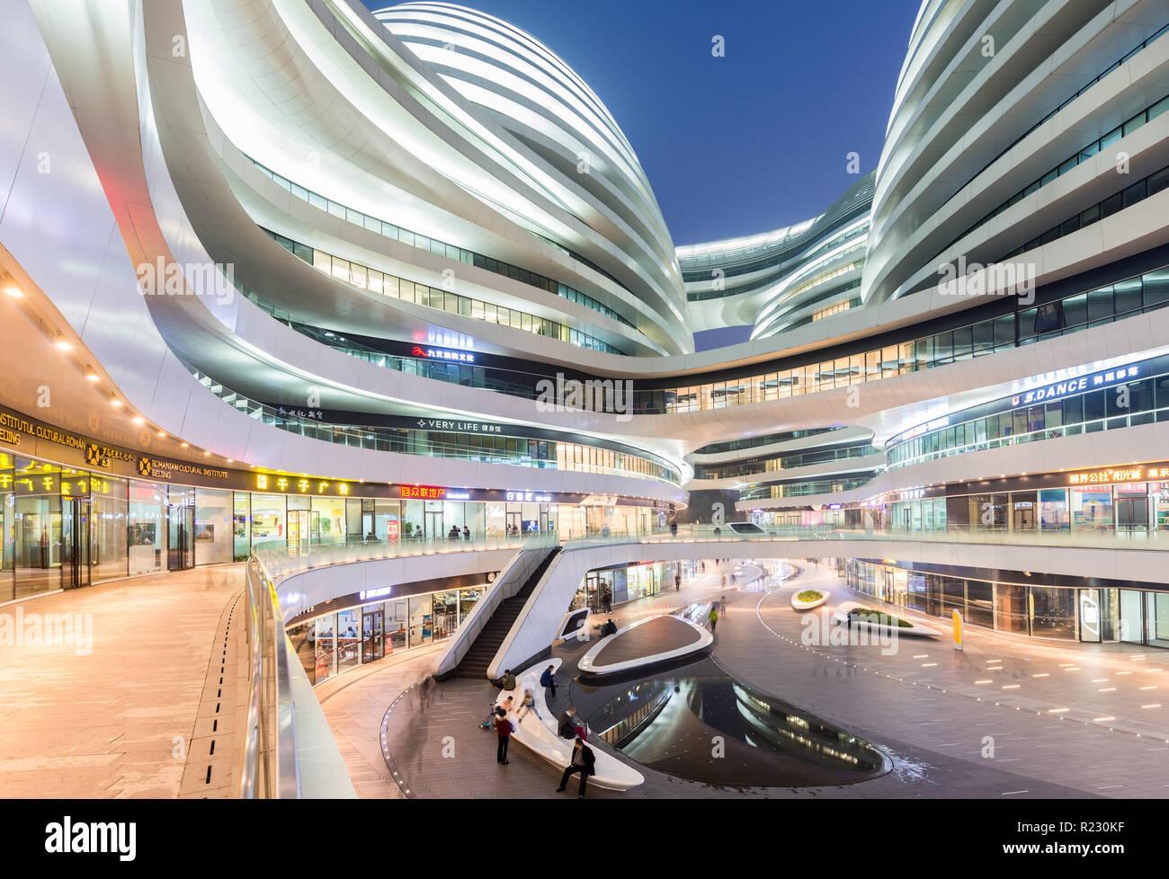 Galaxy SOHO building scene at night in Beijing, China. - Stock Image