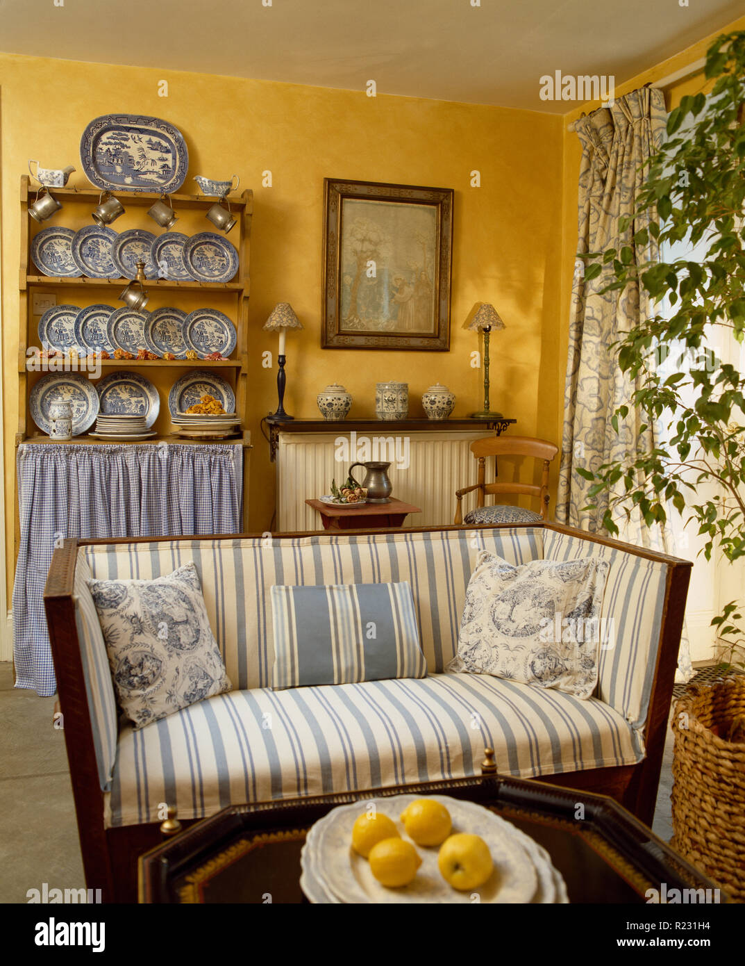 Marvelous Small Blue Striped Sofa In Yellow Sitting Room Stock Photo Alphanode Cool Chair Designs And Ideas Alphanodeonline