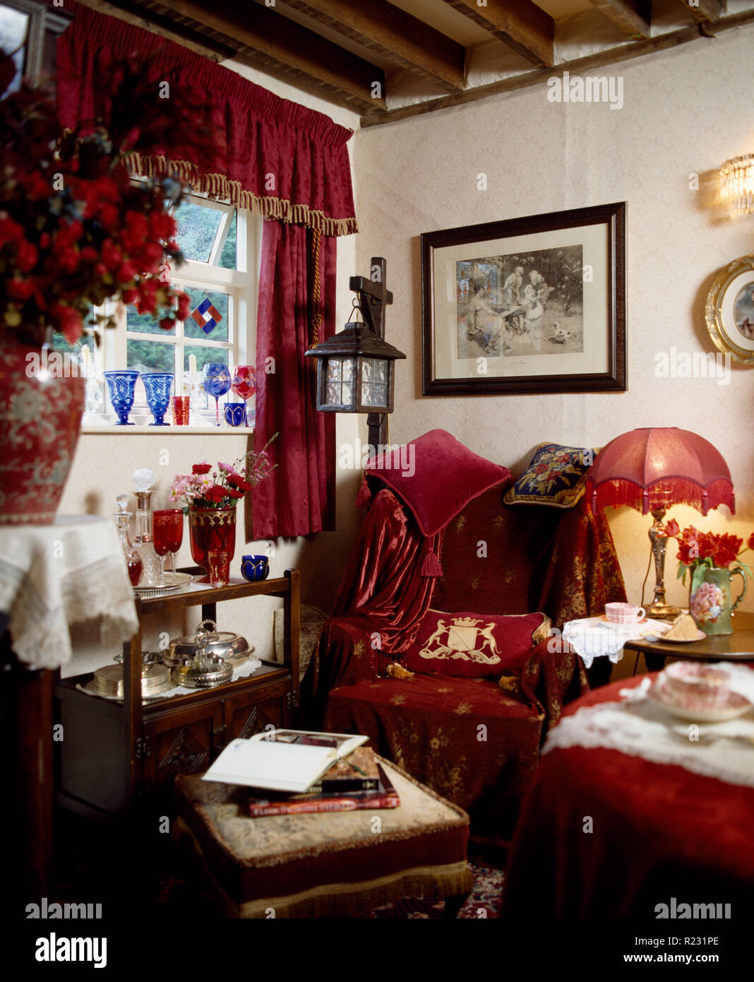 Red curtains in old-fashioned, cluttered sitting room Stock ...