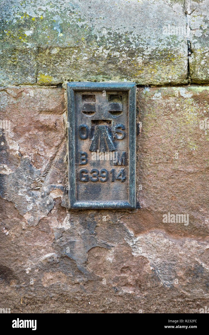 An Ordnance Survey flush bracket, a type of bench mark, on a building in Monmouth. - Stock Image