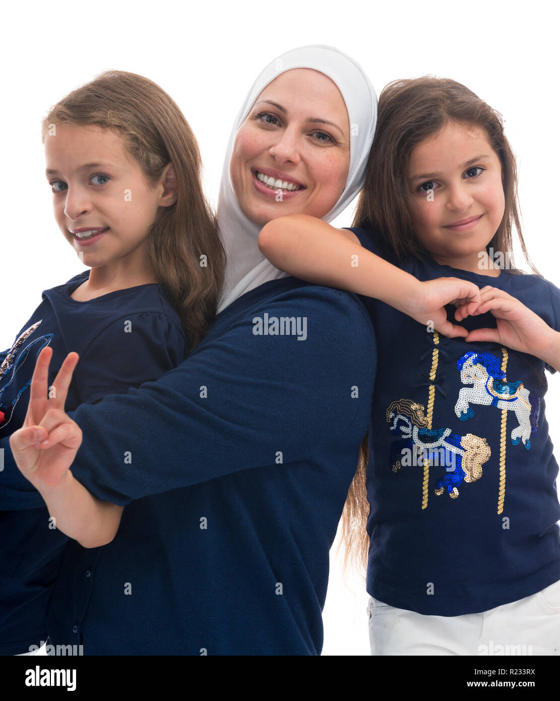 A Happy Muslim Family, Mother and Her Daughters Isolated on White Background Stock Photo
