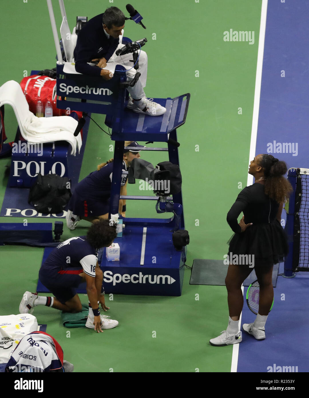 23-time Grand Slam champion Serena Williams argues with chair umpire Carlos Ramos during her 2018 US Open final match at National Tennis Center - Stock Image