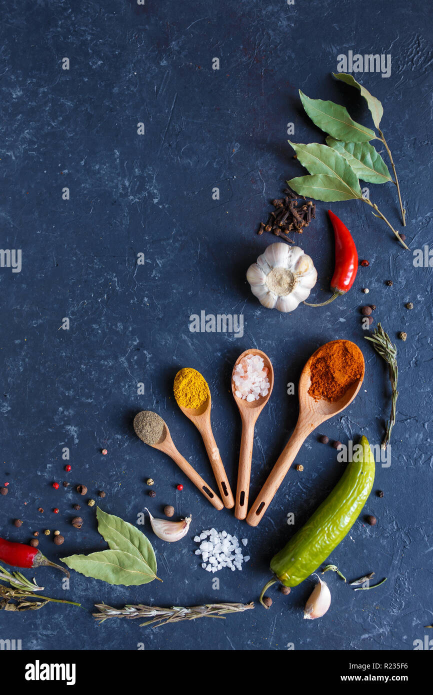 Herbs and spices on black background Food background measuring spoon . spice spoon laurel Copy space - Stock Image