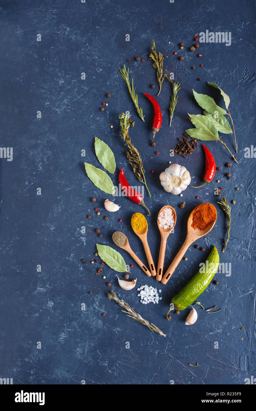 Herbs and spices on black background Food background. measuring spoon . spice spoon Copy space - Stock Image