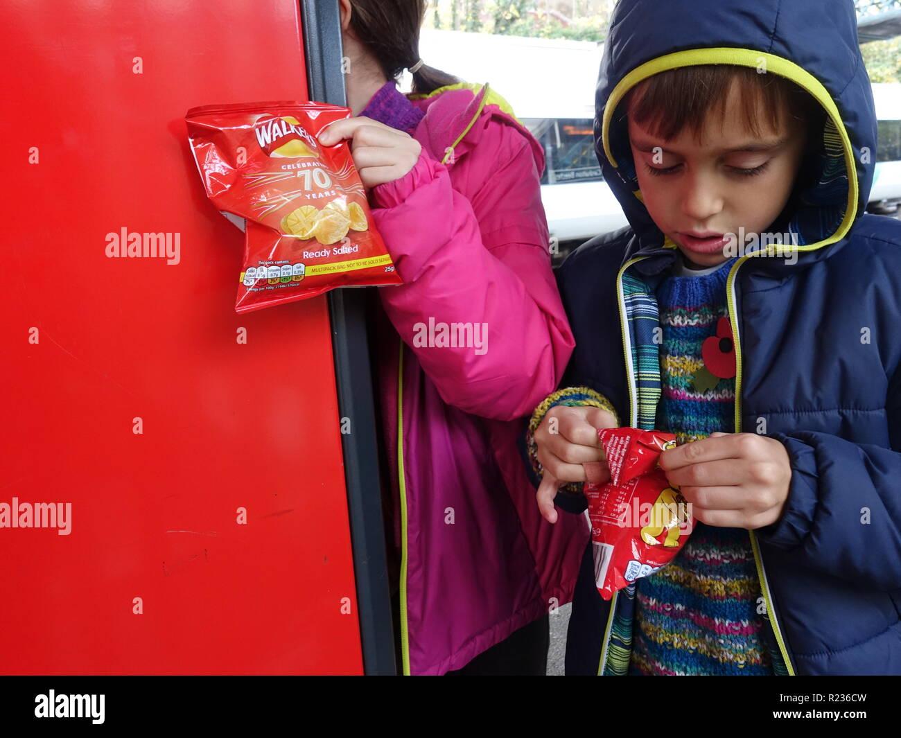Children eating crisps Stock Photo