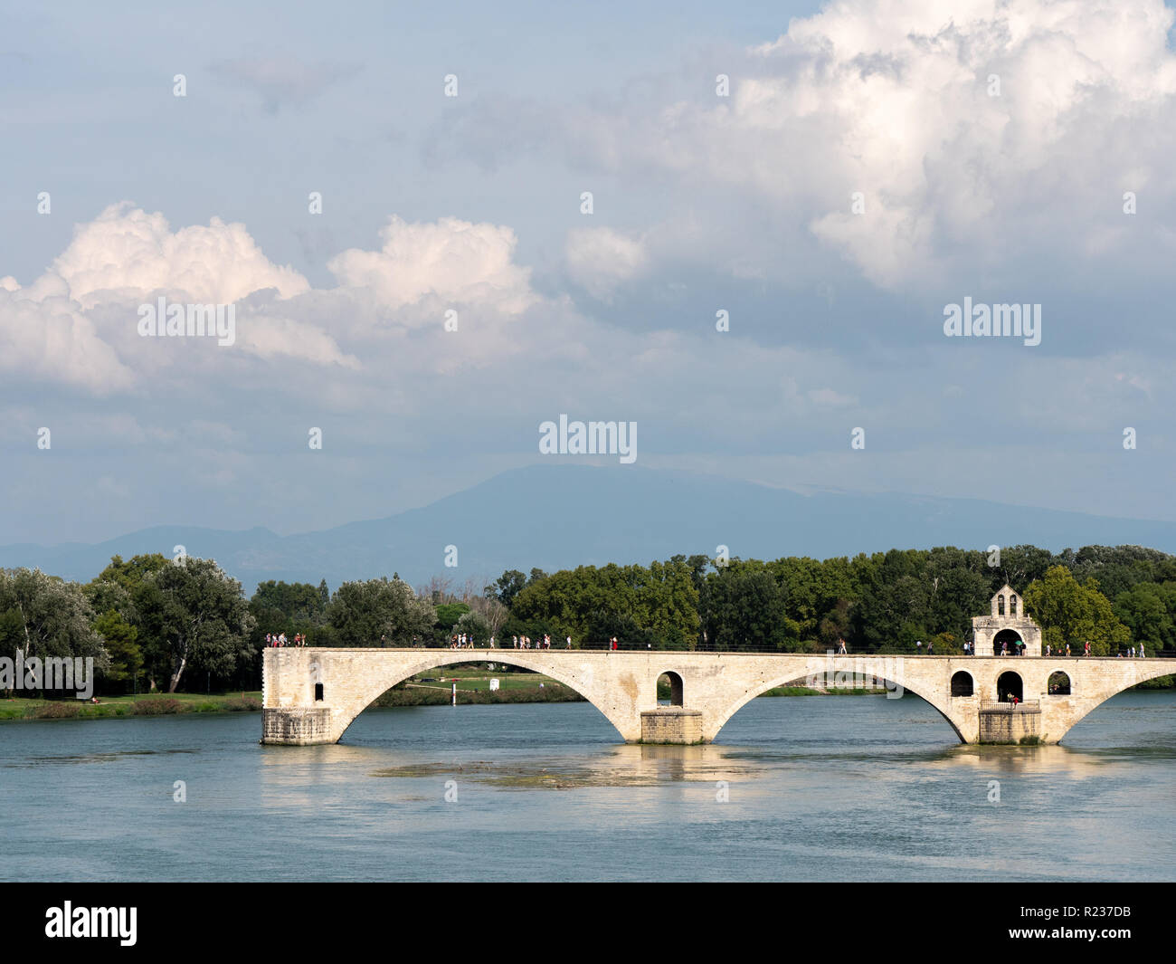 "View on the Rhone river in Avignon, southern France. The river is crossed by a famous medieval bridge called the ""Pont d'Avignon"" or ""Pont Saint-Bénéz Stock Photo"