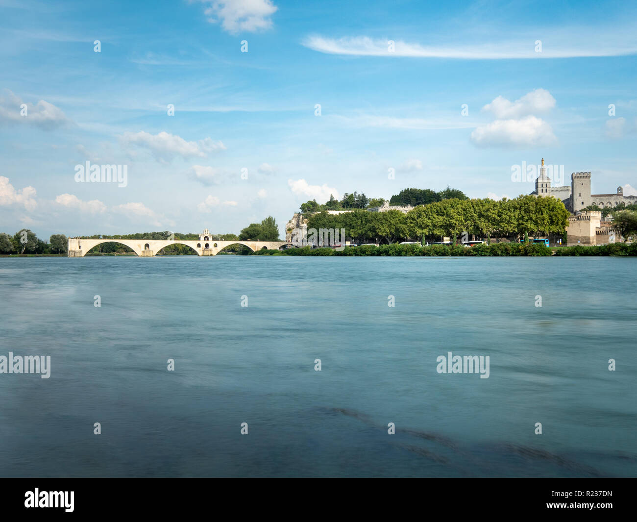 The Avignon bridge and the Papal palace are two touristic attraction built in the medieval time, in Avignon, southern France. The Rhone river cross th Stock Photo