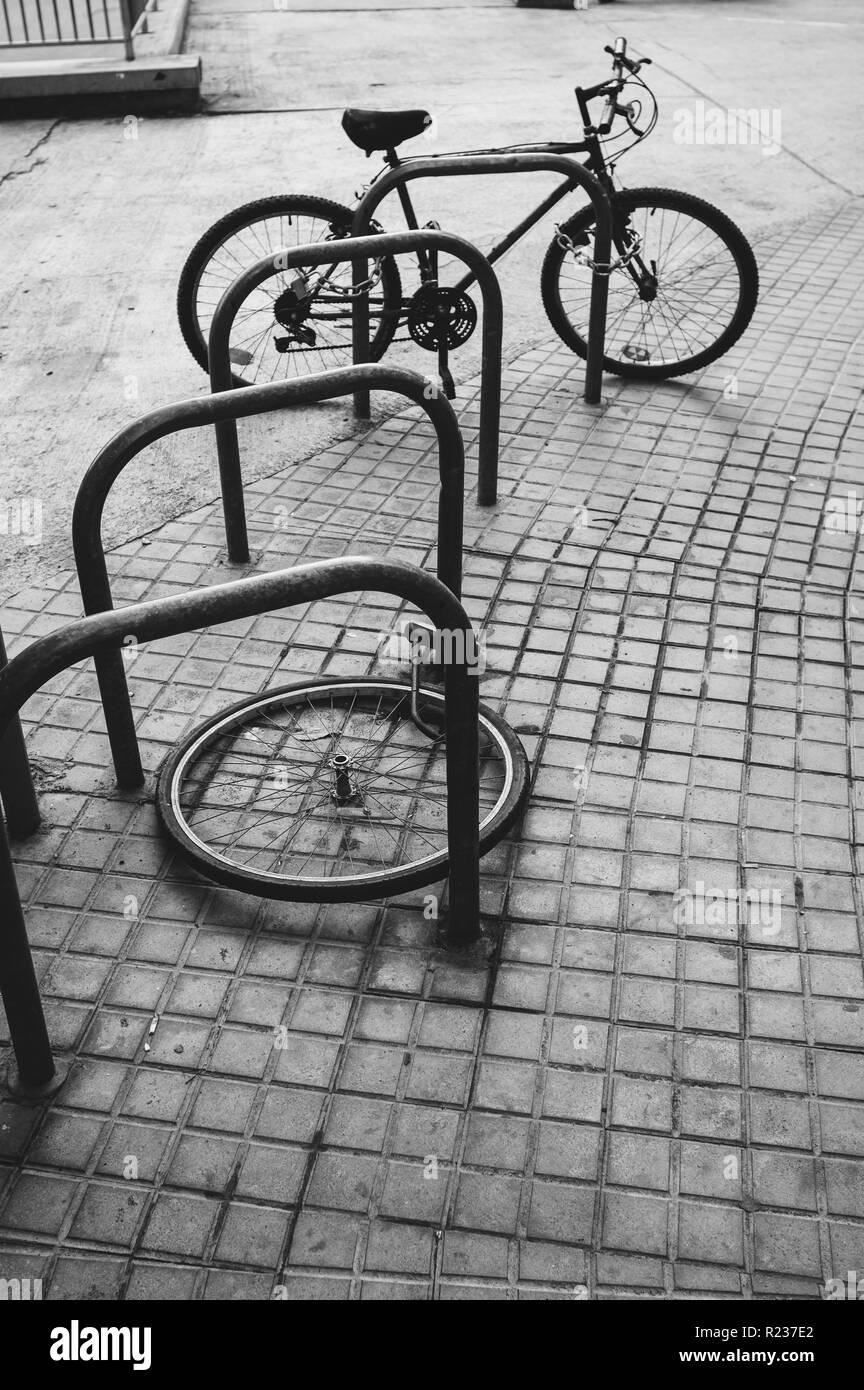 Bicycle wheel with locker lay on the street - Stock Image
