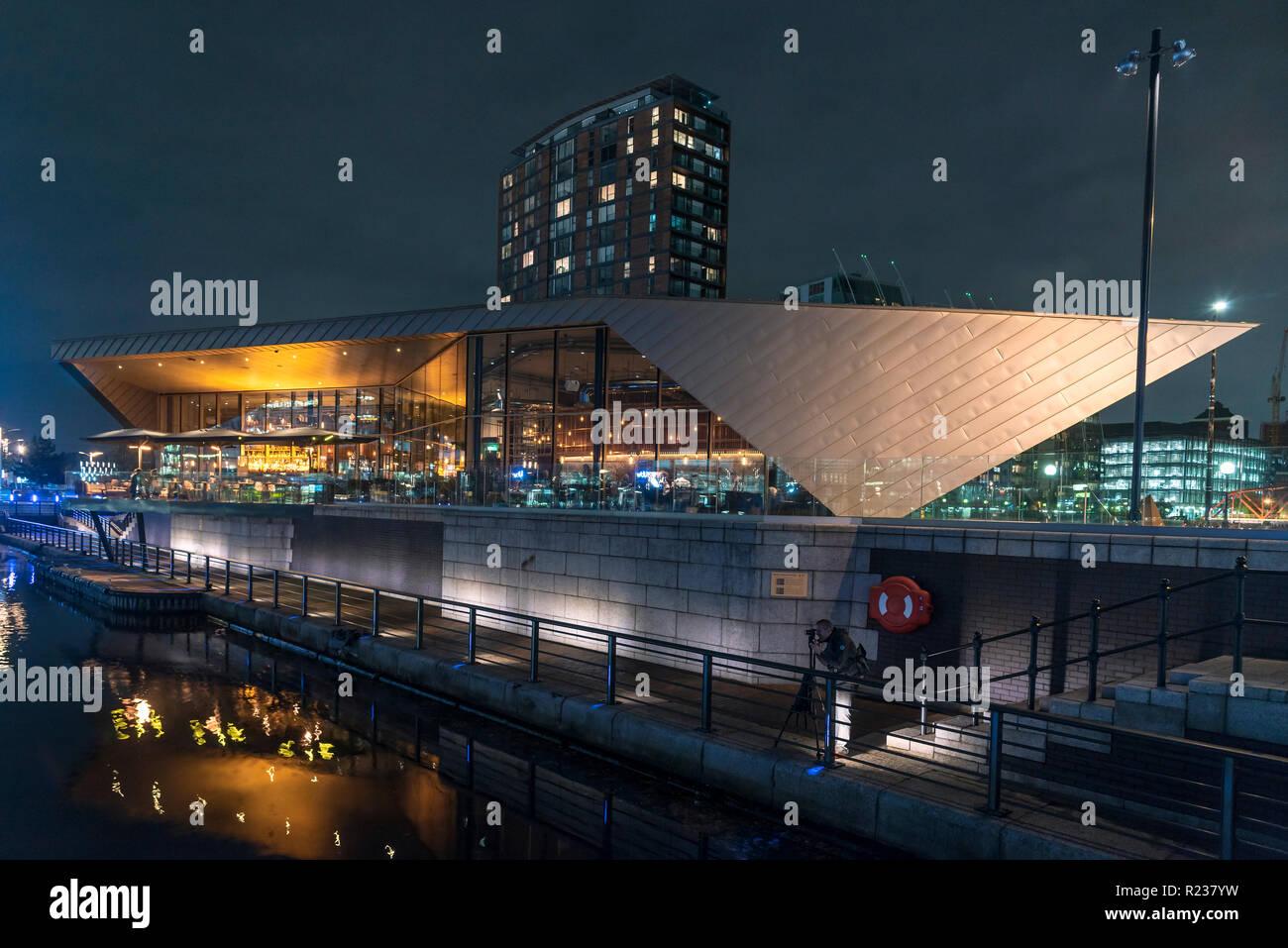 Salford Quays Media city at night. The Alchemist restaurant. - Stock Image