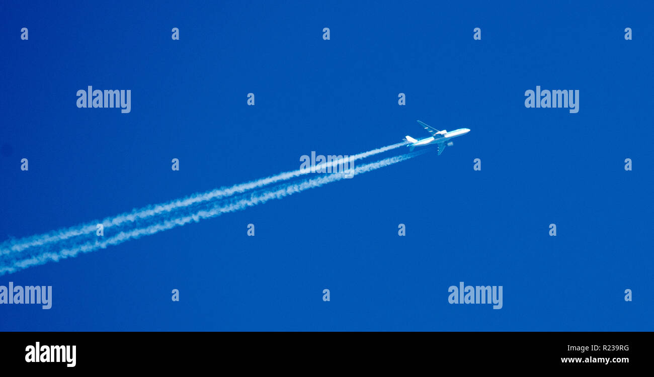 Twin engine airliner against a blue sky - Stock Image