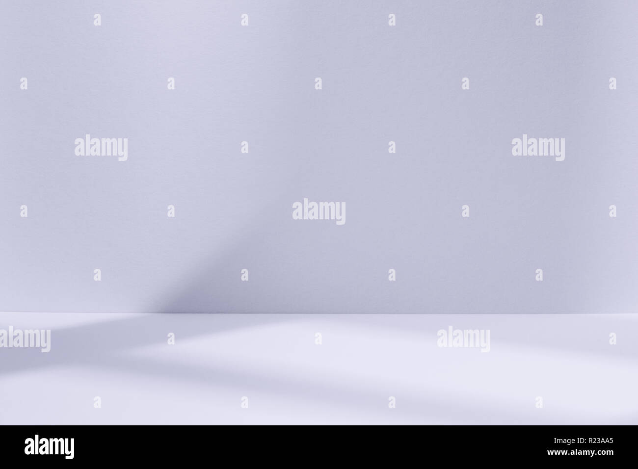 Empty light blue studio space with deep windows shadow. Sparse template and background Stock Photo