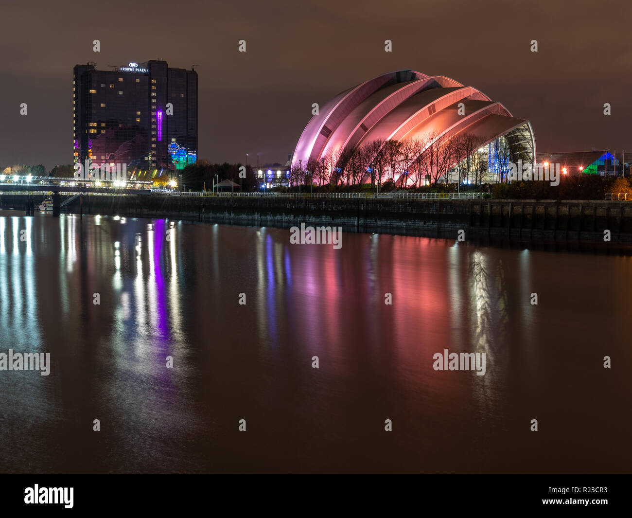 Glasgow, Scotland, UK - November 6, 2018: The modern Armadillo Auditorium and Crowne Plaza hotel buildings stand on the banks of the River Clyde at th - Stock Image