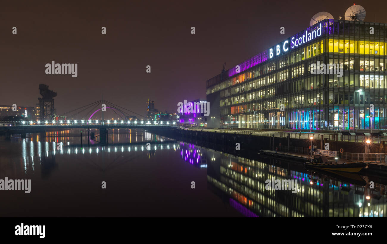 Glasgow, Scotland, UK - November 5, 2018: The offices and studios of BBC Scotland are reflected in the waters of the River Clyde at night in Glasgow. - Stock Image