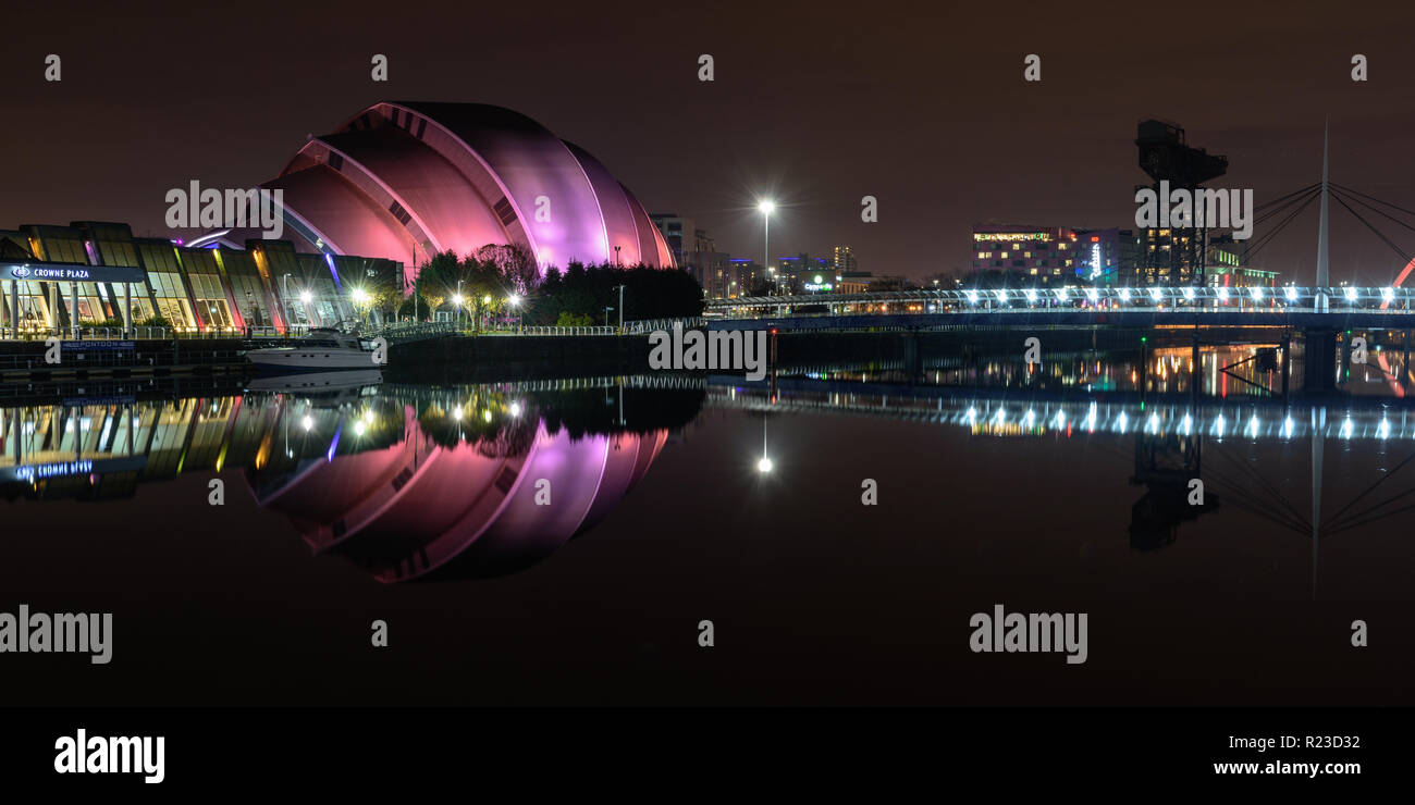 Glasgow, Scotland, UK - November 4, 2018: The 'Armadillo' auditorium building of the SEC is reflected in the calm waters of Glasgow's River Clyde at n - Stock Image