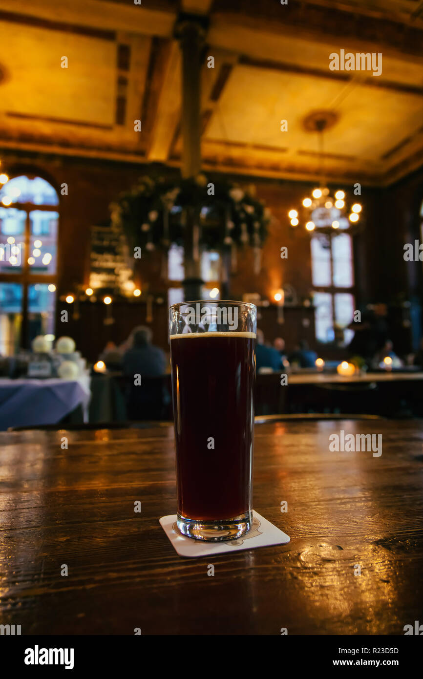 Heidelberg, Germany, February 18, 2018, View of a pint of brown beer on a table of a brewery - Stock Image