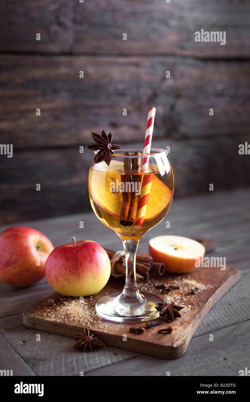 Hard apple cider (sangria, punch, fruit wine) for autumn and winter holidays - homemade festive Christmas, Thanksgiving drink on wooden table, copy sp - Stock Image