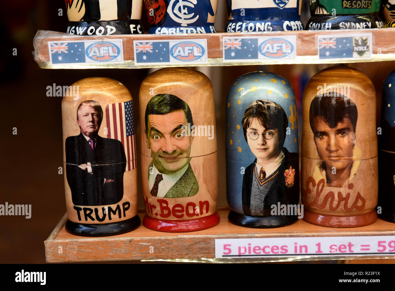 Russian dolls characterising celebrities in a Prague tourist shop - Stock Image
