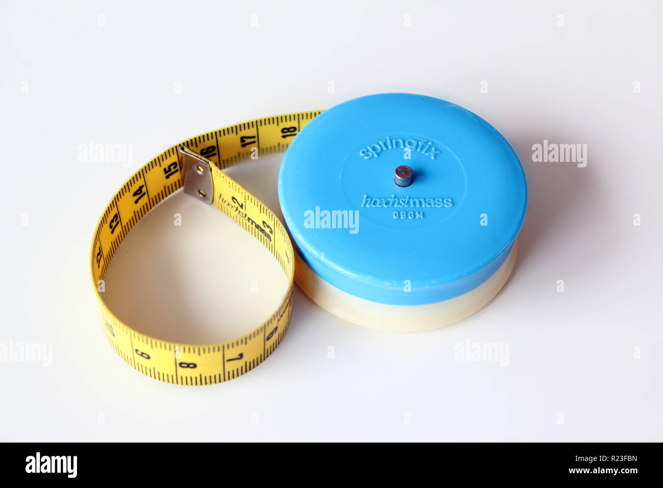 Measuring tape isolated on a white background, close-up - Stock Image