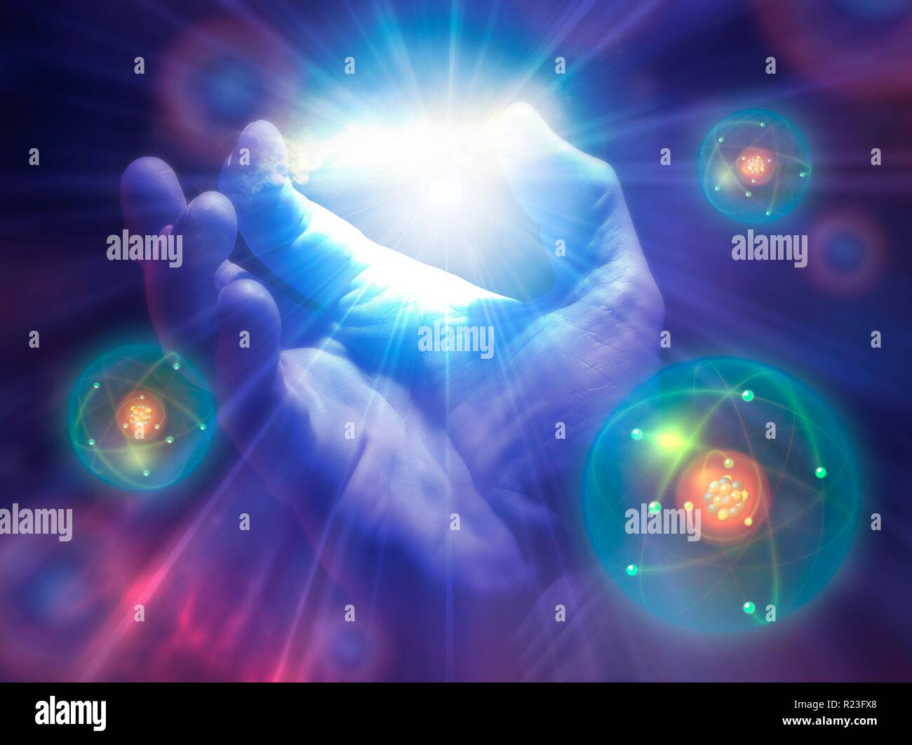 Conceptual illustration of creation. A hand is shown with light rays and atoms emanating from it. - Stock Image