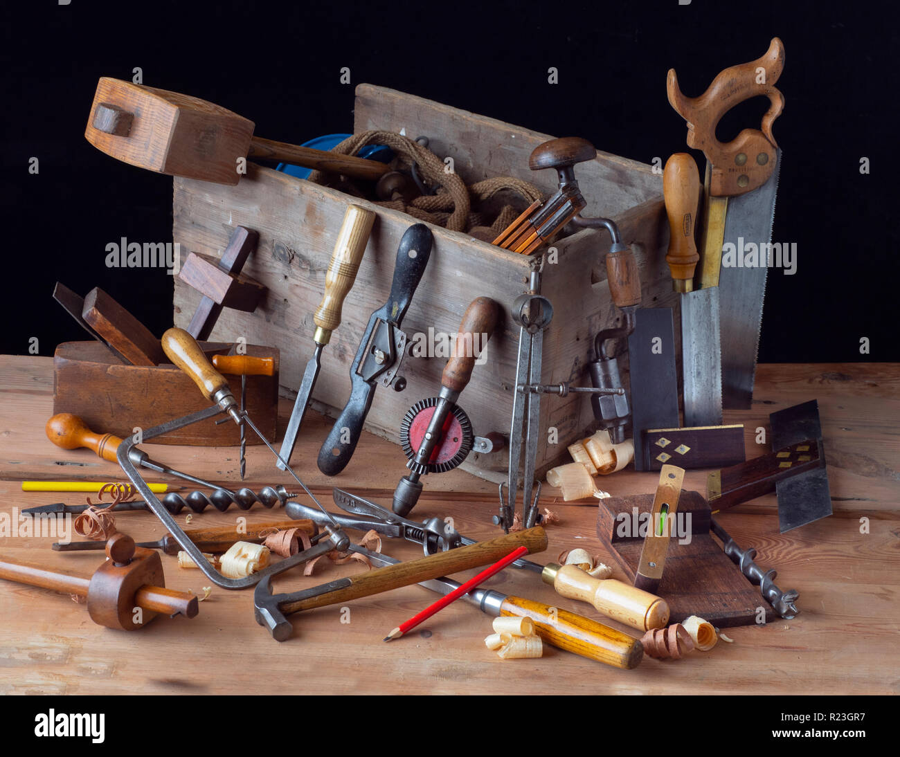 Carpenters tools on woodworking bench - Stock Image