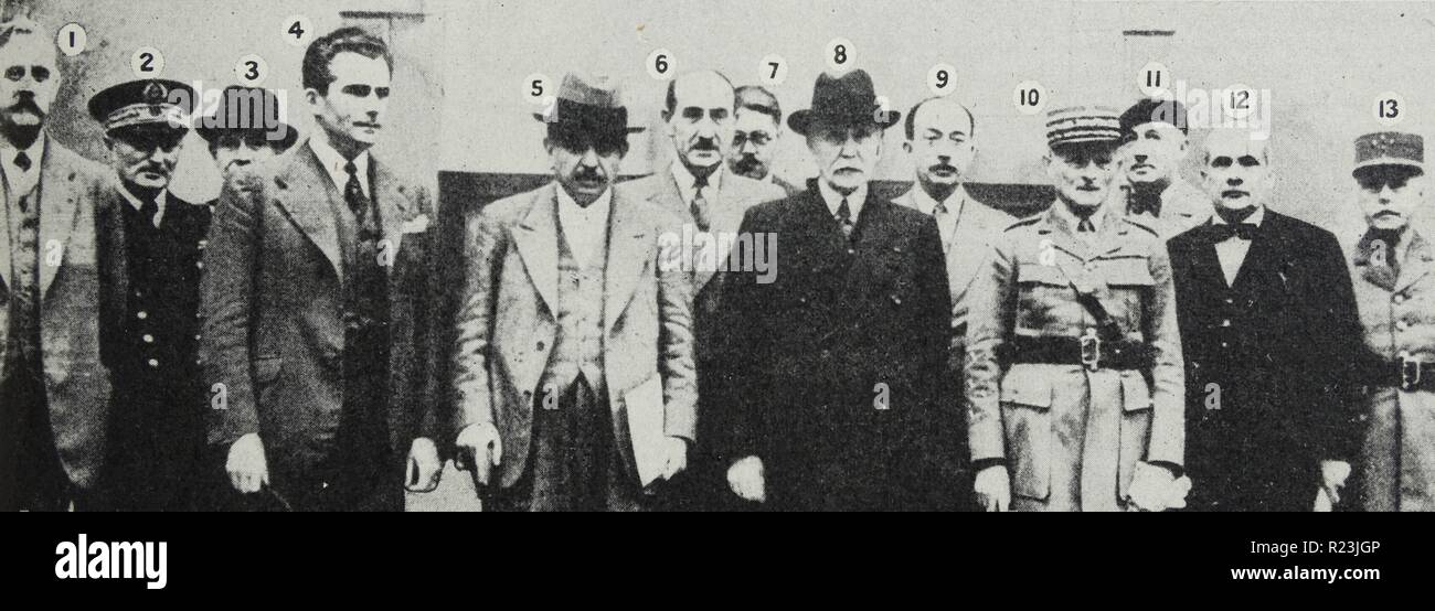 Photograph of the Marshal Petain and the Men of Vichy. Left to right: M. Caziot; Admiral Darlan; M. Pertri; M. Baudouin; M. Laval; M. Marquet; M. Bouthillier; Marshal Petain; M. Mireaux; General Weygand; M. Ybarnegaray; M. Lemery; Gernal Colson. Dated 1940 - Stock Image