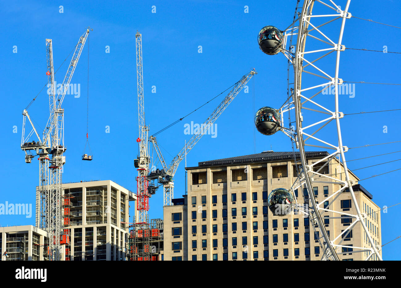 London Eye / Millennium Wheel, Shell Centre and construction cranes on the South Bank, London, England, UK. - Stock Image