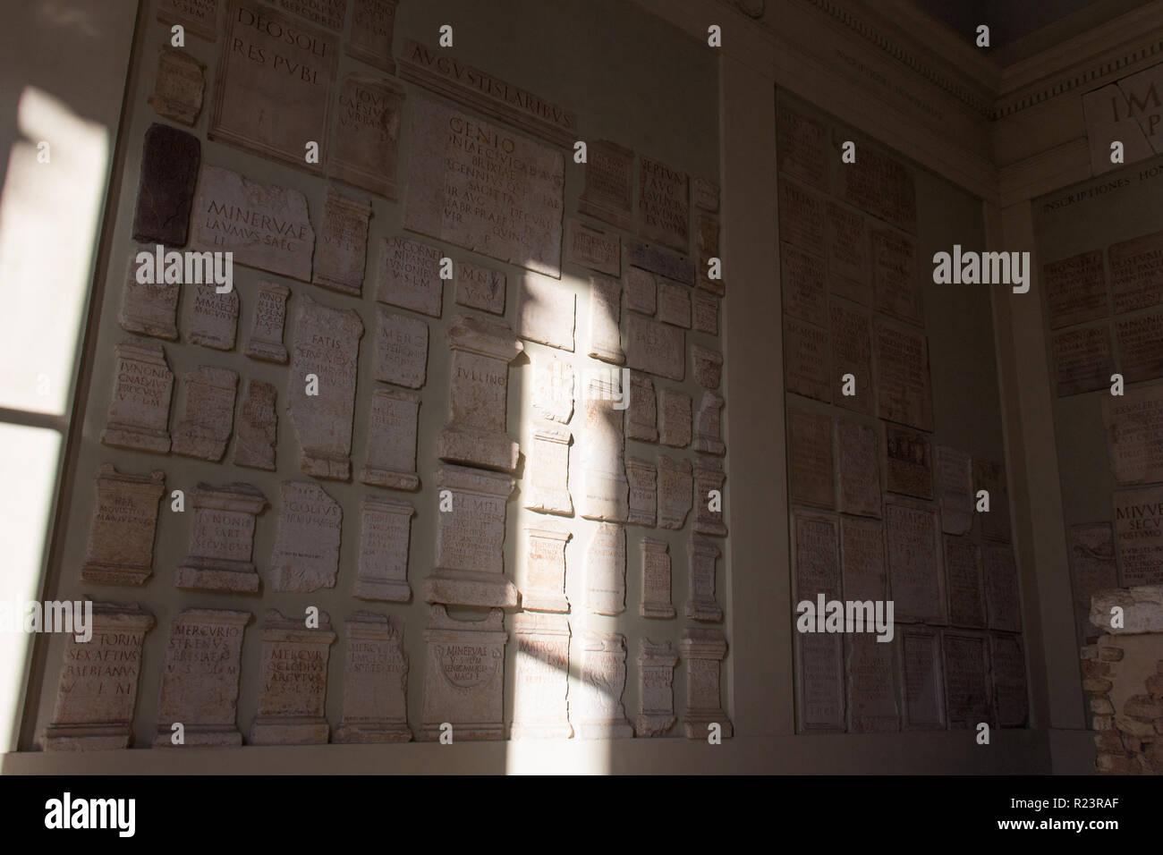 Italy, Brescia - December 24 2017: the view of the lapidarium walls of the Capitolium in Brescia on December 24 2017 in Brescia, Lombardy, Italy. Stock Photo