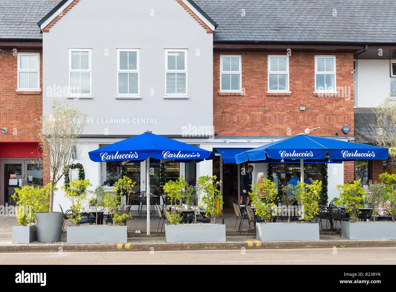 Large blue umbrellas outside Carluccio's Italian restaurant in Stratford-upon-Avon, Warwickshire - Stock Image