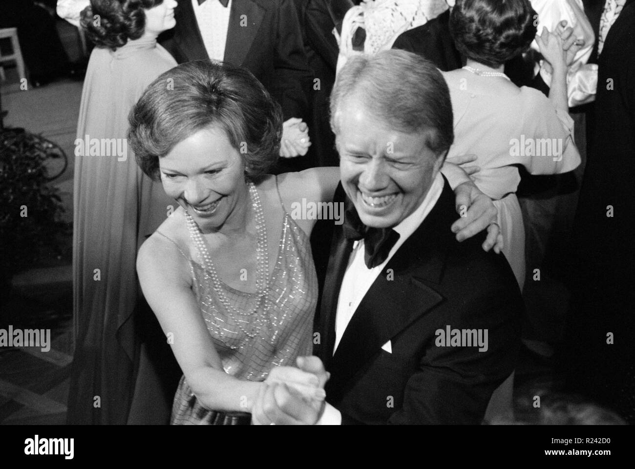 Photograph of President Jimmy Carter and First Lady Rosalynn Carter dancing at a White House Congressional Ball. Photographed by Marion S. Trikosko. Dated 1977 Stock Photo