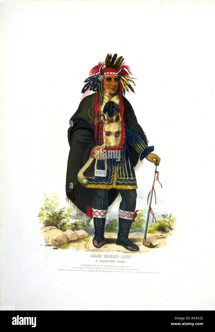 Okee-Makee-Quid a Chippewa chief wearing a buffalo headdress, holding a war club and a long peace pipe. The Ojibwe (or Chippewa) are one of the largest groups of Native Americans in North America. c.1838 - Stock Image