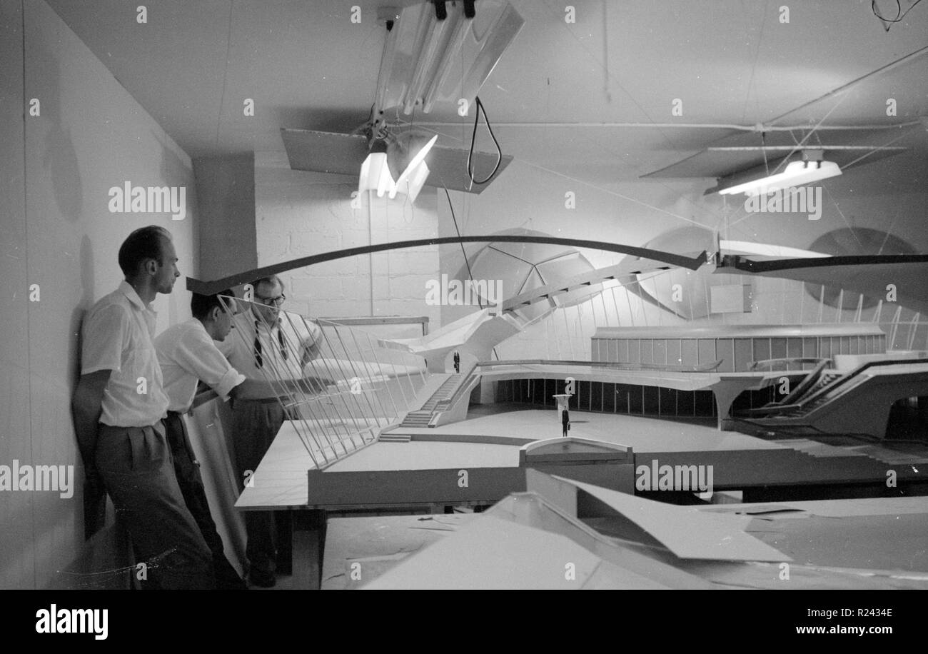 architect Eero Saarinen, 1910-1961, studies a scale model of the Trans World Airlines Terminal, John F. Kennedy (originally Idlewild) Airport, New York, New York, 1956-62. - Stock Image