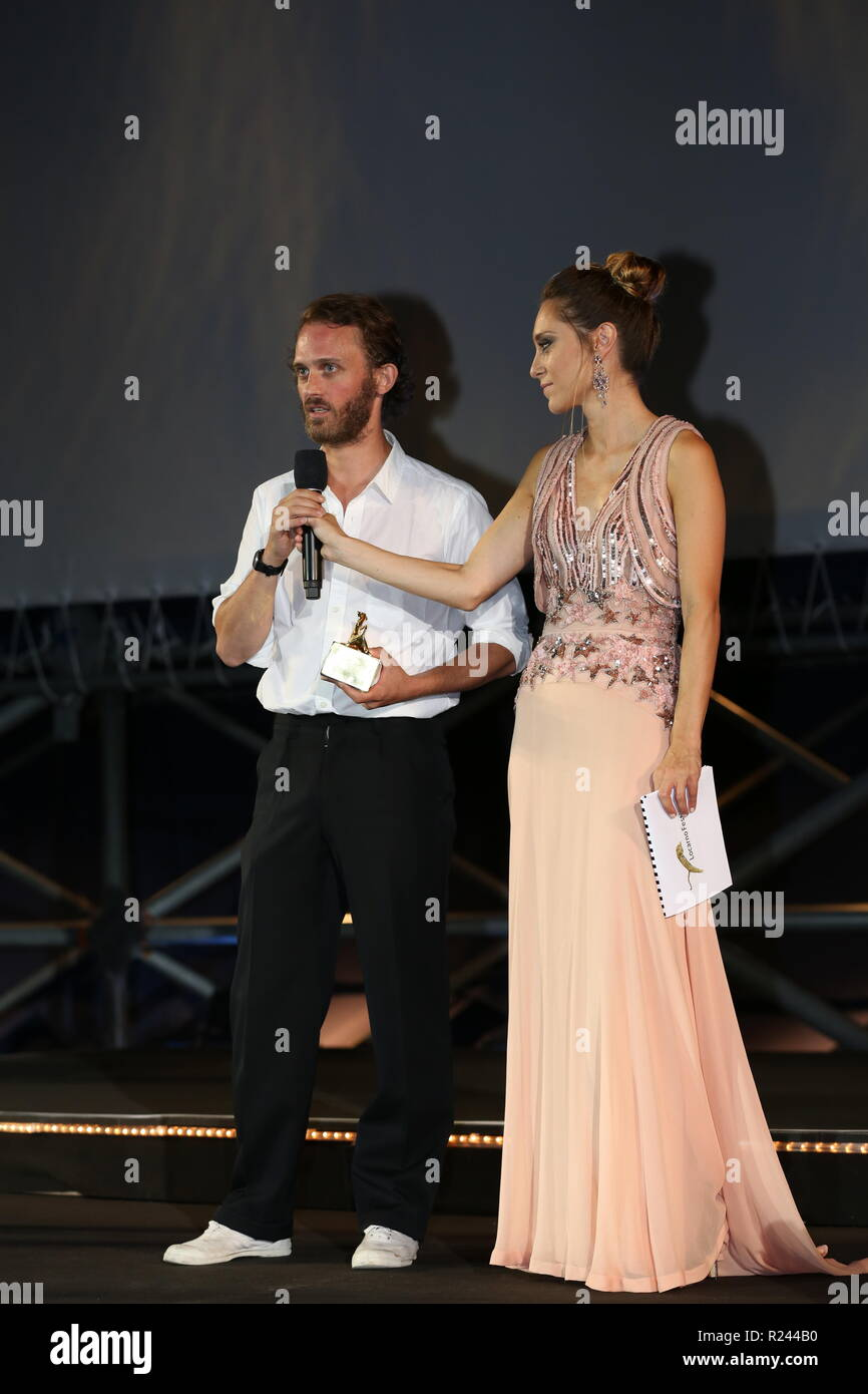 LOCARNO, SWITZERLAND – AUG 11, 2018: Emmanuel Marre wins the Pardino d'Oro for best short film at the 71st Locarno Film Festival (Ph: Mickael Chavet) - Stock Image