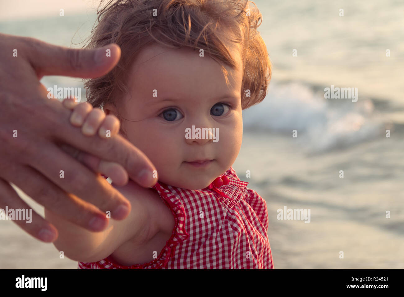 8f52b5b48 Father's hand lead his child girl in summer beach nature outdoor, trust and  together love