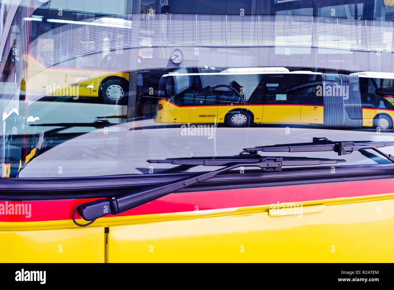 travel car mirrored in a windshield, postauto, switzerland - Stock Image