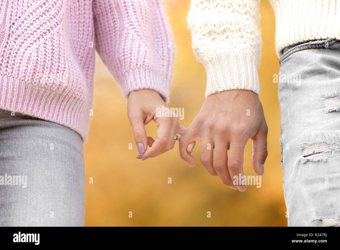 couple in love holding hands and walking Stock Photo