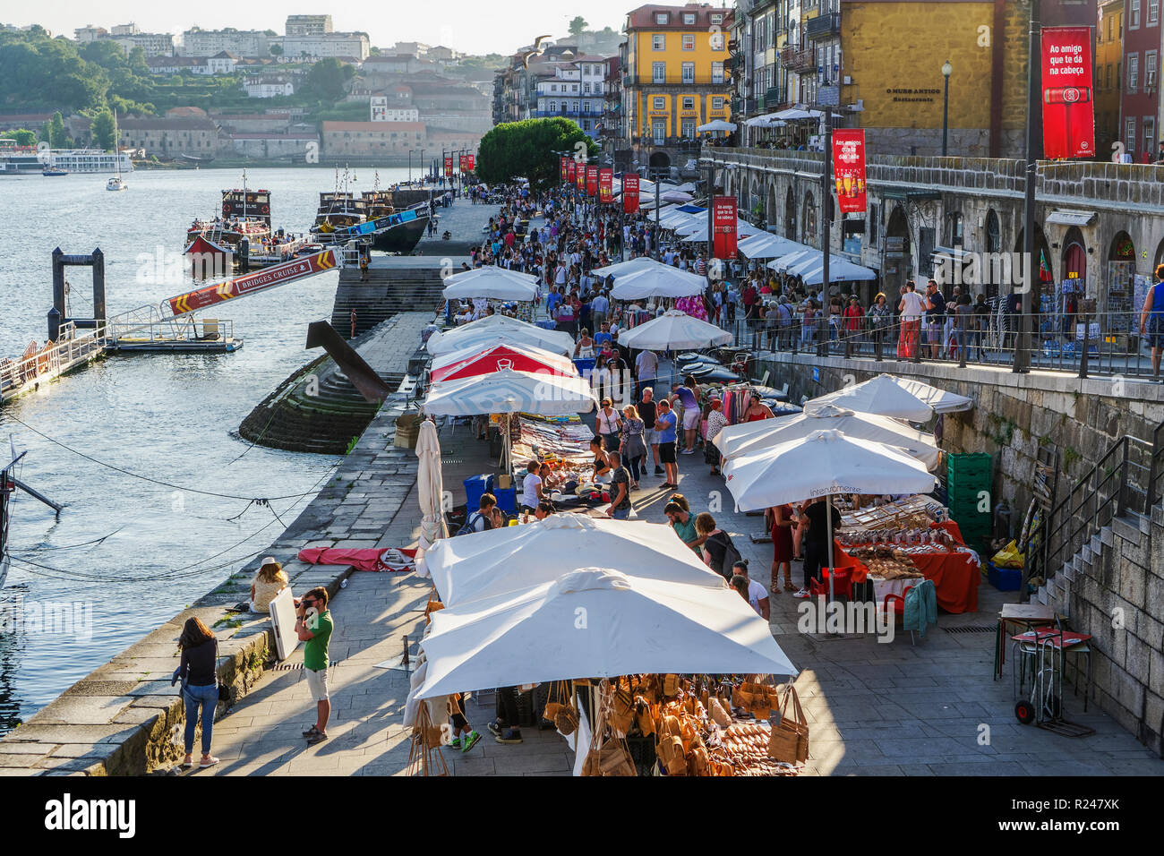 Open air street stalls and markets with cork and gift products on Douro River in Ribeira District, Porto, Portugal, Europe - Stock Image