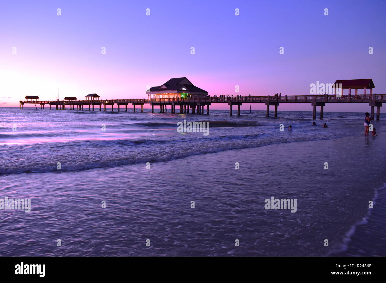 Clearwater, Florida. October 21,2018 Panoramic view of Pier 60 on magenta sunset background at Cleawater Beach. - Stock Image