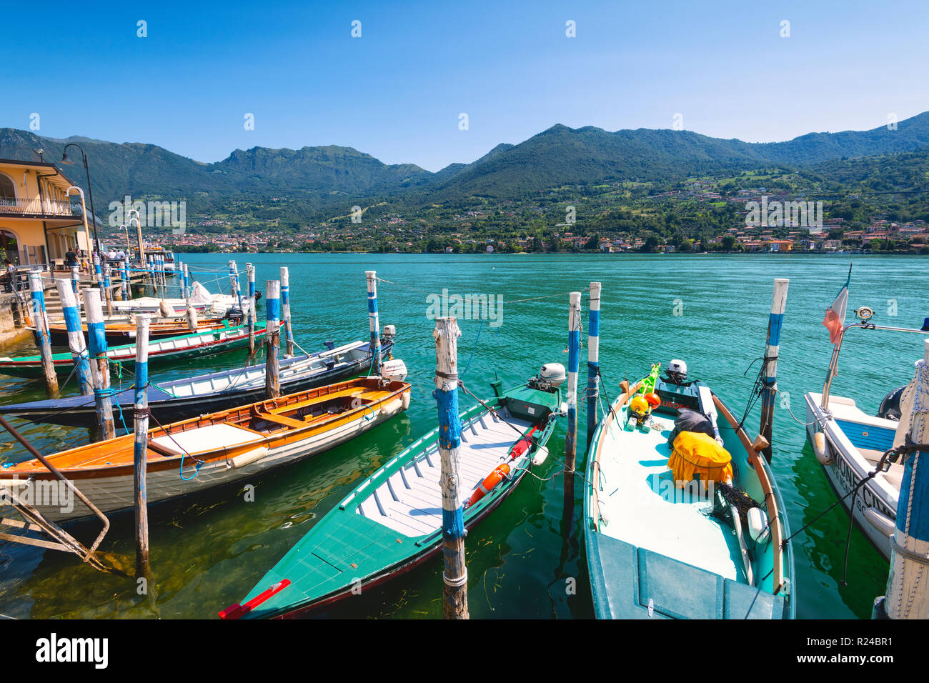 Boats moored at Monte Isola, the largest lake island in Europe, Province of Brescia, Lombardy, Italy, Europe - Stock Image