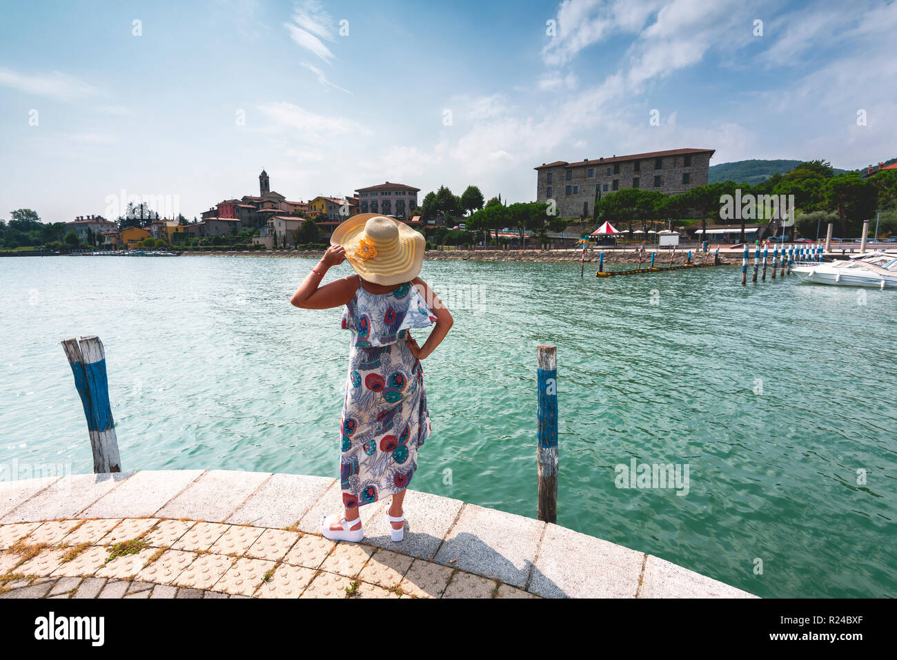 Woman admiring Clusane d'Iseo, Lake Iseo, Brescia province, Lombardy, Italy, Europe - Stock Image