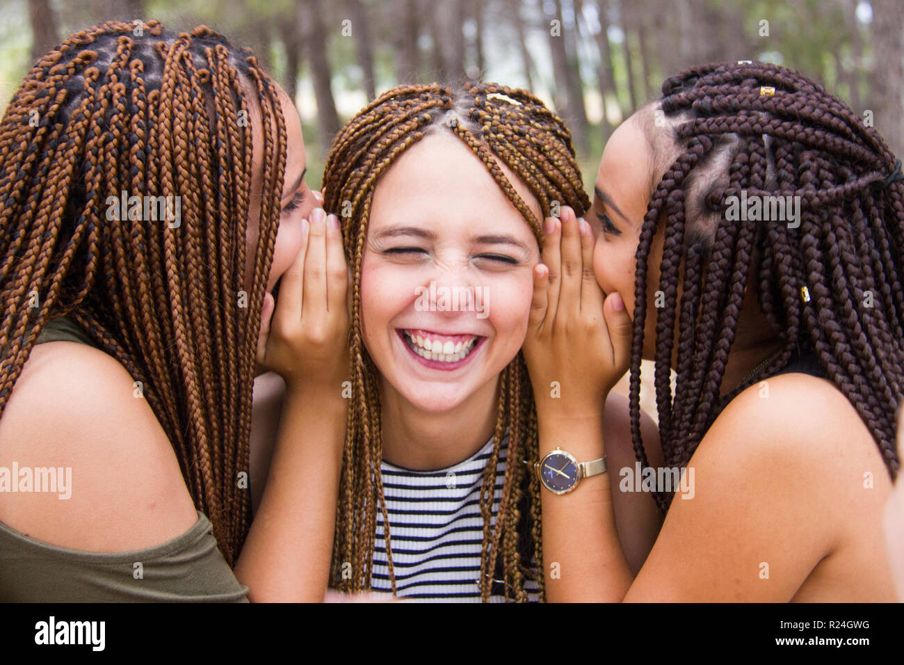 Tremendous Three Young And Beautiful Girls With Braided Hair Laughing And Natural Hairstyles Runnerswayorg