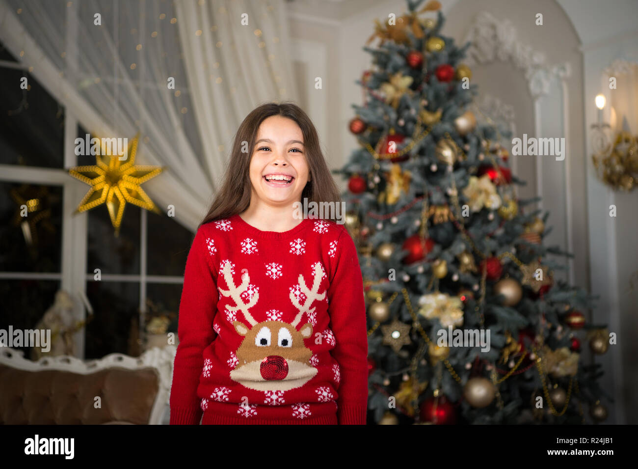 little child girl likes xmas present. New year new goals. The morning before Xmas. New year holiday. Christmas. Kid enjoy the holiday. Happy new year. small happy girl at christmas. happy smile. - Stock Image
