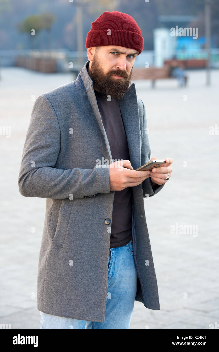 Man bearded hipster stylish fashionable coat and hat. Stylish modern outfit  hat bright accessory. Hipster outfit. Stylish casual outfit for fall and  winter ... 071479227a8