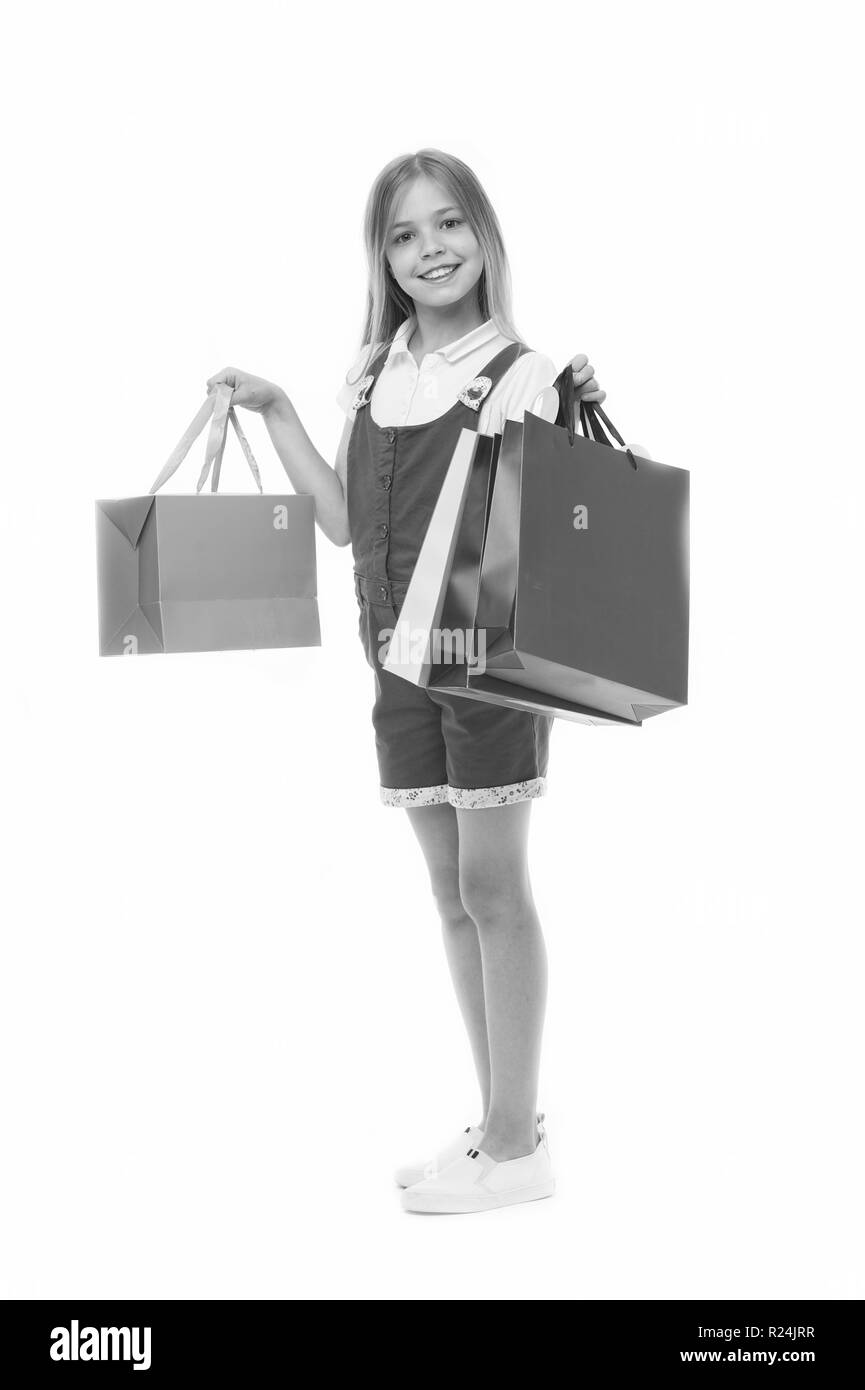 Participate in loyalty programs. Loyalty benefits. Why customers participate in loyalty programs.Girl cute teenager carries shopping bag. Kid bought clothing summer sale. - Stock Image