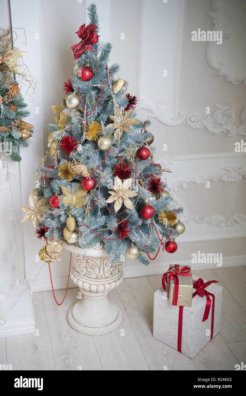 Merry Christmas and Happy Holidays. Christmas. Beautiful decorated tree with present boxes The morning before Xmas. New year holiday. Christmas composition. Happy new year. From Santa. Stock Photo